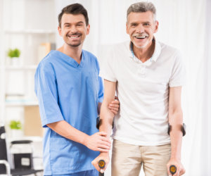 caregiver assisting patient in walkiing